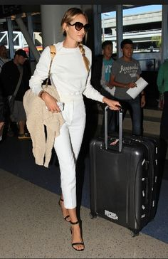 ce7b0345f9 Candice Swanepoel Photos - Candice Swanepoel, Victoria's Secret model,  wears all white as she makes her way through LAX Airport in Los Angeles.