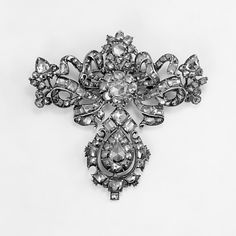 Brooch Date: 18th century Culture: Portuguese Medium: Silver, diamonds Dimensions: 2-5/8 x 2-5/8 in. (6.7 x 6.7 cm) Classification: Metalwork-Jewelry Credit Line: Gift of Marguerite McBey, 1980 Accession Number: 1980.343.17