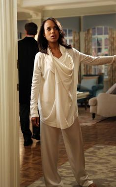 """DONNA KARAN SWEATER, LA PERLA PAJAMA PANTS """"This is the thing we get the most mail about: her lounge wear, her popcorn and wine clothes,"""" shares Lyn. """"I was inspired by women in the '50 and '60s who would wear beautiful lounge wear to dinner parties and I wanted similar silk pants that you could wear out."""""""