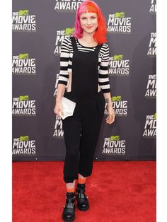 Not only are overalls flattering on everyone, they're also a great way to bring your style from the pool to the party. Our fave look? Layered over a crop top, a la Hayley Williams!