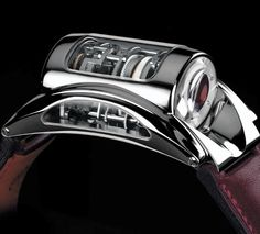The Bugatti Type 370 by Parmigiani Fleurier was designed to mimic the appearance of a transversal engine, and the movement in this driver's watch is actually spread across five separate plates lined in a row.