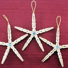 Easy to make DIY clothespin Christmas ornaments.  These look like starfish!  LOVE