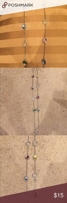 Incredibly long multicolored chain - so cute! Multi colored jems match everything & long chain allows for versatility. Jewelry Necklaces