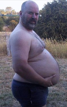""""""" Daddy knows his ballgut looks even bigger from the side."""