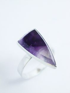 Ring with Amethyst & Quartz, set on raised stem.  Silver (925)  Hand-crafted  A beautiful gemstone with natural inclusions with the blended colours of the Amethyst & Quartz  Amethyst is a meditative and calming stone which works in the emotional, spiritual, and physical planes to provide calm, balance, patience, and peace.  Size Small (British size L)  Dimensions: Band Width 3mm.. Thickness 0.8mm Gemstones 19x10mm.