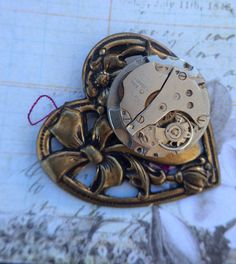 A personal favorite from my Etsy shop https://www.etsy.com/listing/213366690/heart-steampunk-pin-handcrafted-artistic