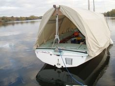 Hooped boom tent on a wayfarer dinghy - I'm not sure how that would work in any wind.
