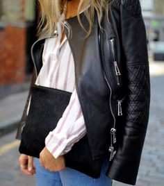 black leather motorcycle jacket + striped button-up shirt + black calf-hair clutch