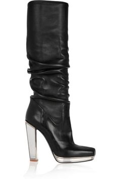YVES SAINT LAURENT TALL BOOTS  Slouchy boots attract extra attention with a mirrored heel and platform.