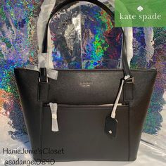 """Brand new and 100% authentic Color: black Features: Soft saffiano Tote with zip closure Kate Spade jacqard lining Exterior zip and slide pockets Interior zip and dual slide pockets Floating kate spade new york signature Dimensions: 11.4""""h x 16.1""""w x 5.1""""d Drop length: 9"""" Kate Spade Totes, Kate Spade Tote Bag, Brand New, Zip, Tote Bags, Color Black, Exterior, Closure, York"""