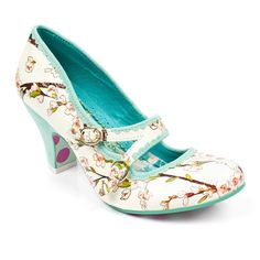 Whistle while you walk in these magical mid heels featuring oriental style floral leather and mint green faux suede heels.   Sole design may differ from pictured.