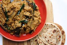Vankaya Pulusu is an Andhra aubergine stew with coconut, curry leaves and tamarind. This curry is perfect for the autumn months.