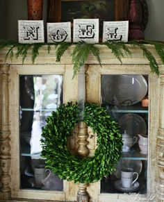 {Christmas Home Tour} Boxwood wreath, antique painted cabinet, sheet music decor