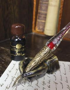 Poet's Pose Pen Rest - Poised mid-script, a burnished brass hand cradles a choice writing utensil while multitasking as a paperweight.