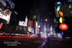 The streets of New York City. Bright lights illuminate the city until late at night.