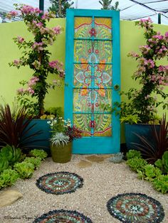 Colorful Landscape. Turquoise Door.  Green Cement Fence.  Delightful Path.  Succulent Garden.  Climbing Flowers.