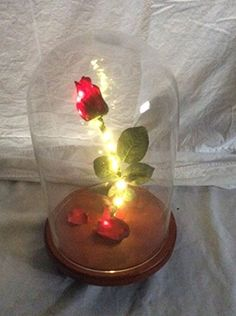 Bring Disney love joy and beauty to any person or home with this beautiful life size hand made beauty and the beast rose. It is a one of a kind piece that will get everybody talking. It is 13 inches tall by 9 inches wide. The rose sparkles and lights up to give it that magical look. 25 mini LED lights light up the rose from top to bottom.  This is a must have for any Disney collector or just a beautiful piece to put on the dining room table or desk!