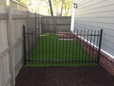 Side yard solution! Pet friendly X-Grass artificial turf dog run.