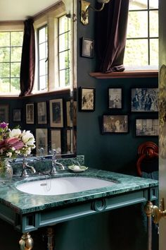 Discover bathroom tiles ideas on HOUSE - design, food and travel by House & Garden. A gorgeous malachite topped sink is paired with bottle-green walls.