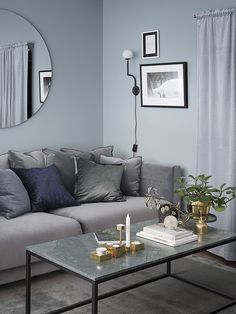 Cosy Scandinavian living room, with interior decor in shades of grey and blue. Living Room Decor Grey And Blue, Living Room Colors, Living Room Paint, Living Room Interior, Living Room Designs, Living Rooms, Bolia Sofa, Scandinavian Living, Scandinavian Interior