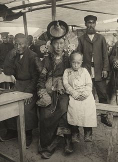 Mongolia | A wealthy woman poses with her daughter. | ©Horace Brodzky