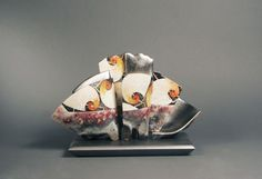 "Bennett Bean  is a sculptor and painter who works in clay. He is primarily known for his hand formed vessels that are decorated post firing with gold leaf and colorful abstract patterns and shapes. ""Master #1598"", Triple on Base $ 8,000    Pit-fired, painted, and gilded earthenware.   6""h x 9.5""w x 4.25""d"