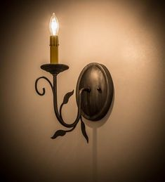 Luxurious charm & elegance-Victorian Lodge wall sconce features a single light-Stunning Iron Ore finish with matching leaves-Faux candlelight-Made in USA. Vintage Pendant Lighting, Iron Ore, Scroll Design, Cool Lighting, Wall Sconces, Bordeaux, Wall Lights, Bulb, Victorian