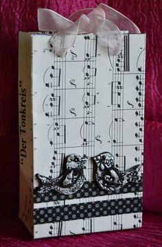 Turn vintage music sheets into DIY favor bags and add a touch of romance to your special day. #FaveCrafter