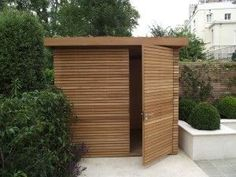 contemporary horizontal wood | garden shed. Need this for gardening tools, bikes etc