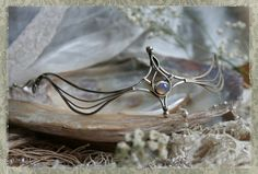 Hey, I found this really awesome Etsy listing at http://www.etsy.com/listing/122225566/elvic-silver-opal-tiara
