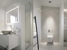 white bathroom with touches of grey