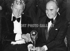Sir Alf Ramsey, England football manager with Bobby Moore (1941 - 1993), England captain, holding the Jules Rimet World Cup trophy after England's World Cup final victory. (Photo by Evening Standard/Getty Images)