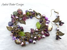 Purple flowers. Stone, Czech glass, lampwork glass, crystals, chain and bronze metal bracelet and earrings set.
