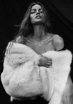 Fur coat. Adore the bare skin- imagining a bold turquoise necklace decorating her collar bones.