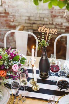laser cut table number - photo by Sarah McKay Photography http://ruffledblog.com/modern-romantic-wedding-with-freixenet