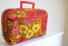 Mod •~• orange, pink, red, and yellow floral suitcase
