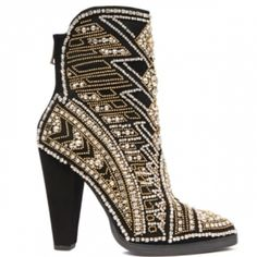 These boots are so edgy and fun! Loving the beading and metallic detailing! Reminds me a bit of tribal patterns!