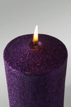 glittery purple candle - lovely to look at, but it's usually dangerous to burn the glitter - it catches FIRE