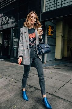 Plaid jacket over graphic t-shirt | pointed-toe blue leather ankle boots | black jeans | quilted black leather bag