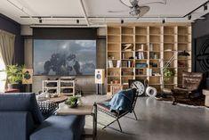 """Loft in taiwan, """"Recall-house"""", HAO-design-designboom-02. Open space living room, concrete floor, industrial lights, wood shelf."""