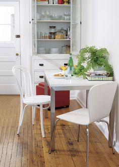 Parsons White Top 48x28 Dining Table with Stainless Steel Base  | Crate and Barrel $659