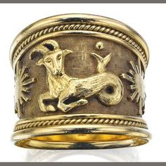 An gold 'Zodiac' ring, 1990, by Elizabeth Gage, London; portrayed is the zodiacal sign of Capricorn, the goat-fish. (Bonhams)