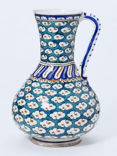 Jug | Iznik, Turkey, ca. 1585 | Fritware, polychrome underglaze painted, glazed | The potters of Iznik, north-west Anatolia, often combined Islamic and Chinese elements in their patterns. The S-shaped clouds on this jug, for example, are Chinese in origin | VA Museum, London