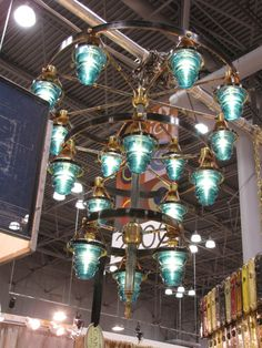 I'm thinking wine barrel rings would make a good start to a similar lamp such as this one. I always wondered what to do with those old glass insulators too...