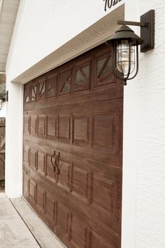 Transform your garage door to a gorgeous faux wood door with this easy gel stain DIY garage door makeover!