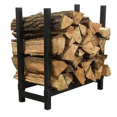 Black Steel Indoor Firewood Log Rack Description: This steel firewood rack is functional inside or outdoors. The feet have endcaps to help with movement and Indoor Firewood Rack, Firewood Holder, Firewood Logs, Firewood Storage, Fire Pit Accessories, Fireplace Accessories, Recycled Trampoline, Fireplace Logs, Fireplace Ideas