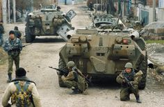 Russian soldiers clearing the town of Samashki, Chechnya. December 1999.
