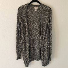 Lightweight black and white cardigan This lightweight Cardigan featuring a combination of grey/black/white will complete any outfit. It is in good condition, and size small. Mudd Sweaters Cardigans