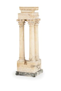 A WHITE MARBLE ARCHITECTURAL SPECIMEN of Roman Ruins, 19th Century ; based on a square green marble socle. - Dim.: H. 45 cm, W. 14 cm, D. 14 cm.