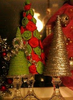 Christmas trees out of paper plates and tissue paper.dollar store candlesticks as trunks